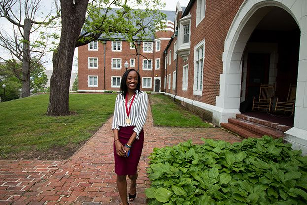 Photo of Nneoma Nwankwo walking outside of hillcrest hall